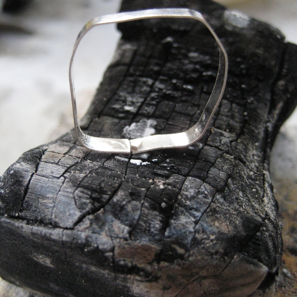 Bezel of silver on charred soldering block